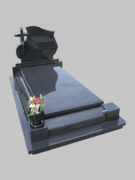 Black granite tombstone with a cross