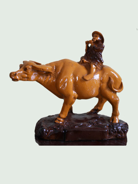 Fluting Boy on Buffalo Resin Figurine